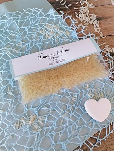 ANNE - Bustina porta riso schiacciata trasparente (12x6 cm). Inserto personalizzato spillato con stampa fronte/retro. Riso non incluso.