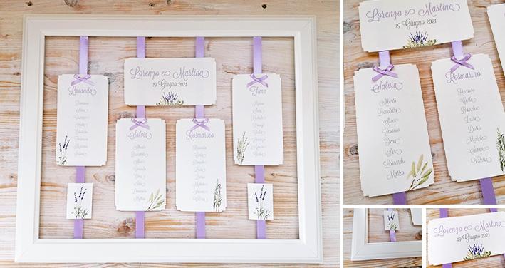 LAVANDA - Tableau con cornice bianca con nastro e cartellini per assegnazione tavolo/invitato applicati. Senza pannello dietro per esaltare la trasparenza. Misure: 50x70 cm.